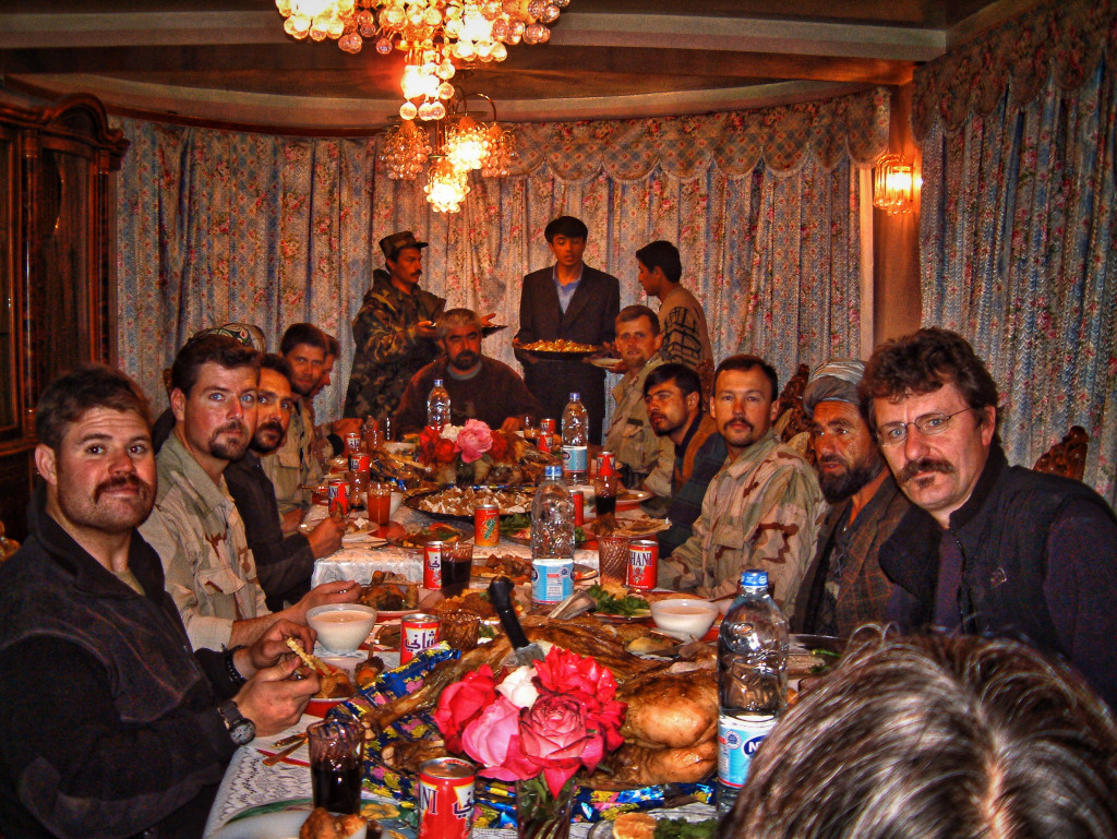 In between conflict there was time to celebrate.  A typical meal at Dostum's guesthouse.  © Robert Young Pelton, all rights reserved