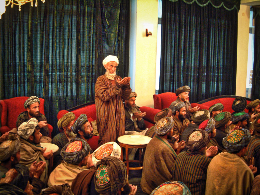 A local mullah sings a prayer of deliverance and thanks to Dostum. © Robert Young Pelton, all rights reserved
