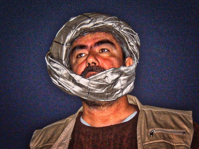 Dostum, triumphant on a return to the simple village of his brith. © Robert Young Pelton, all rights reserved